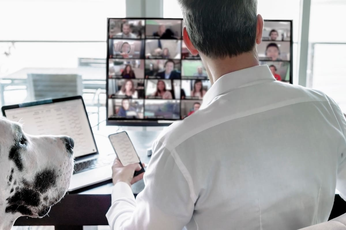 man-working-remotely-video-chatting-with-team
